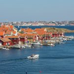 Fiskebackskil, Sweden - July 9, 2014: View over Fiskebackskil an old fishing village on the Swedish west coast, with Lysekil city in the background